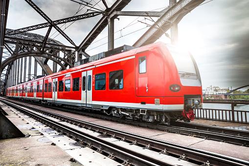 Passenger Train passing on a bridge in Frankfurt, Germany.