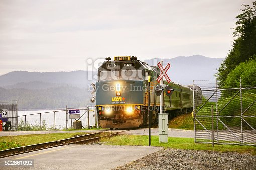 Prince Rupert, Canada - June 26, 2011: Passenger train to Prince George approach to the platform by the port at early morning time.
