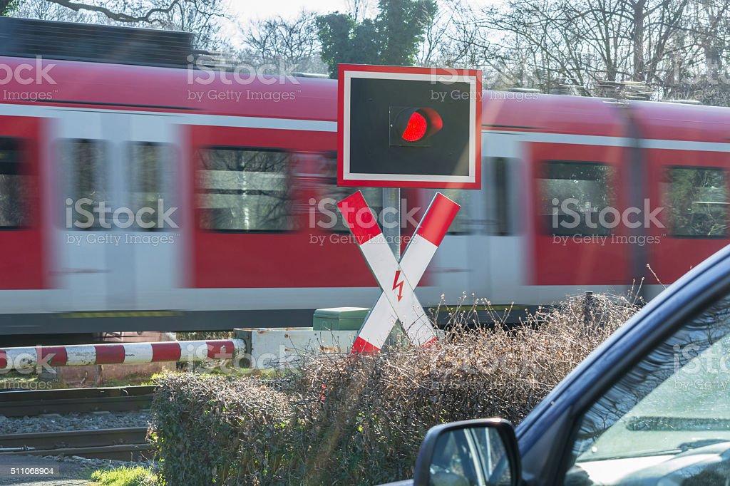 Passenger train transit at the railroad crossing stock photo