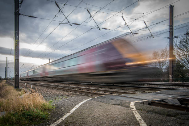 passenger train travels at high speed - rail stock photos and pictures
