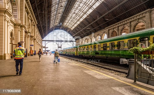 Budapest, Hungary -August 29, 2019: platform of the old Keleti railway station and passenger cars in Budapest, Hungary. Railway public transport in Europe. Ancient building and tourists in the station building