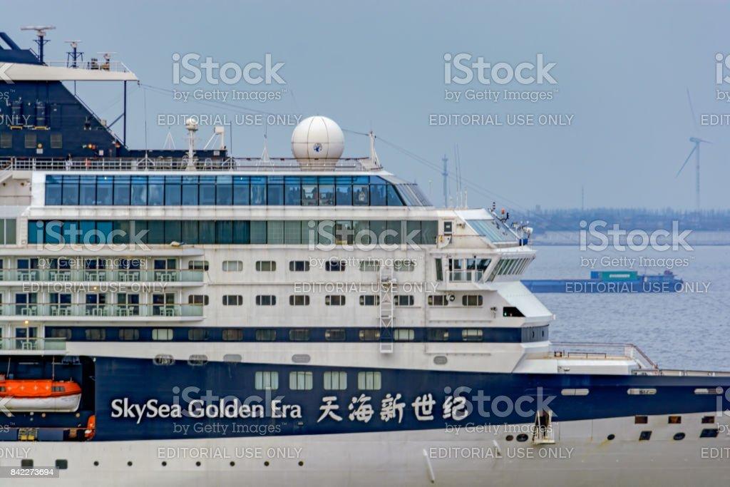 Passenger vessel SKYSEA GOLDEN ERA in Shanghai harbor in service for SkySea Cruises. stock photo