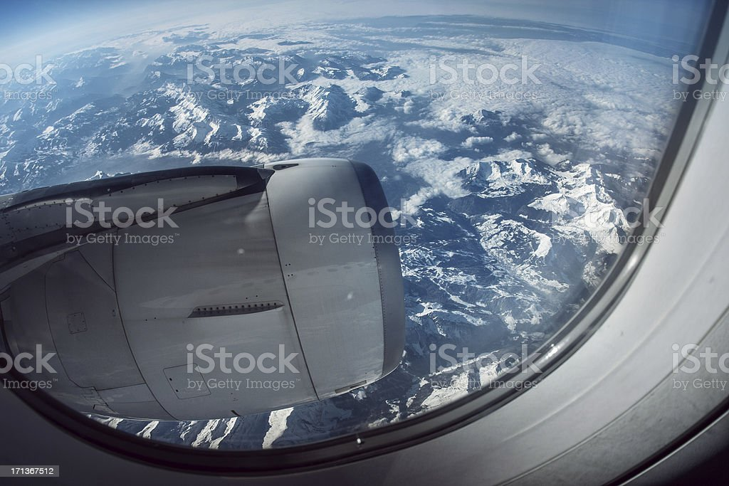 Passenger view from an Airplane: over the Alps royalty-free stock photo