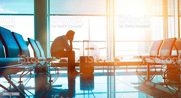 Passenger Waits For Plane In An Airport Stock Photo - Download Image Now