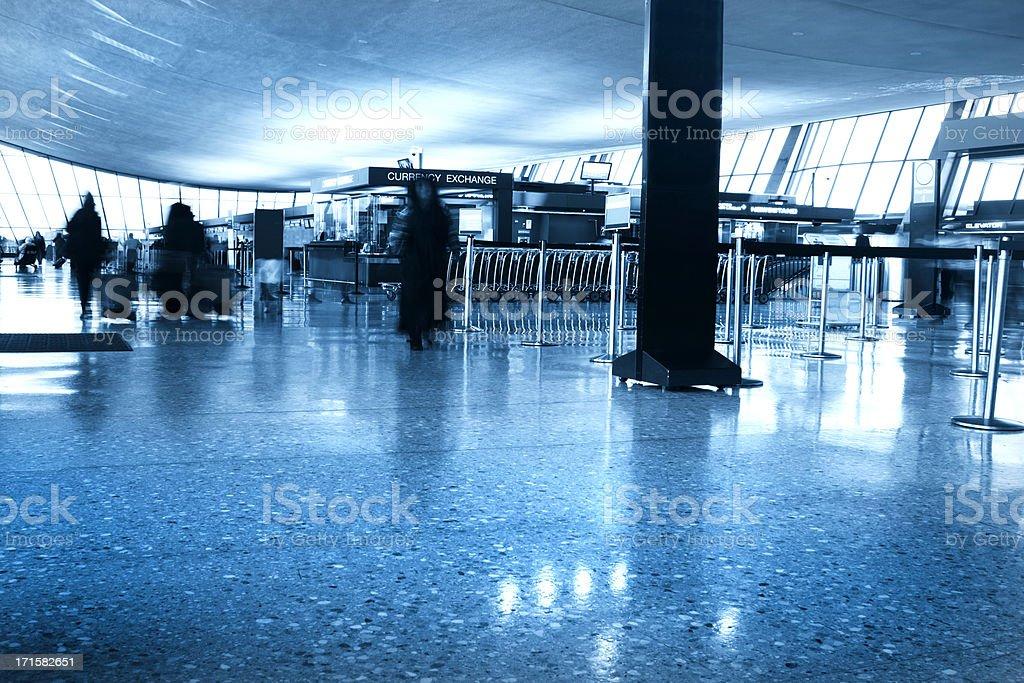 Passenger walking at an airport royalty-free stock photo