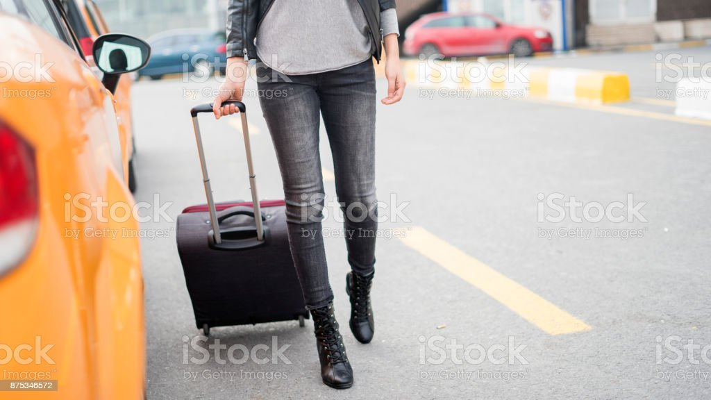 Passenger walking  at the airport with suitcase stock photo
