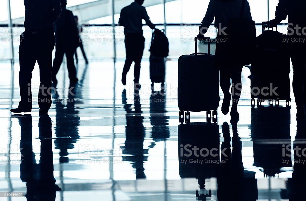 Passenger walking in the airport stock photo