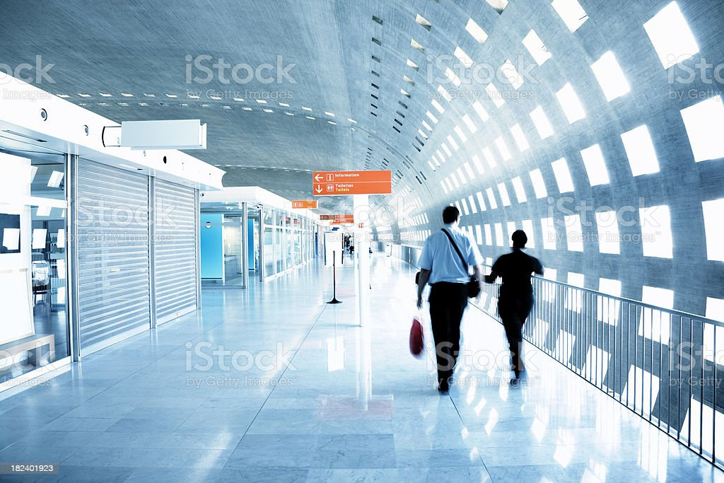 Passenger Walking Through an Airport Corridor, Blurred Motion stock photo