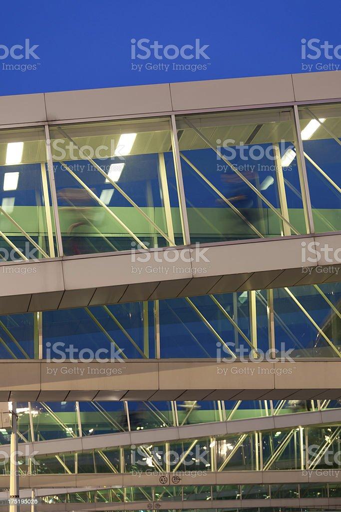 Passenger Walking Through an Airport Corridors, Blurred Motion royalty-free stock photo