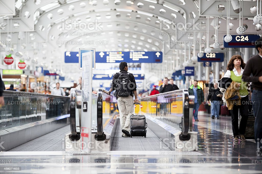 Passenger walking through Chicago O'Hare International Airport royalty-free stock photo