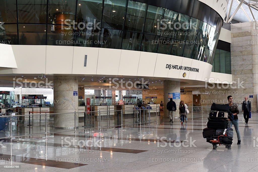 Passenger with luggage at international terminal stock photo