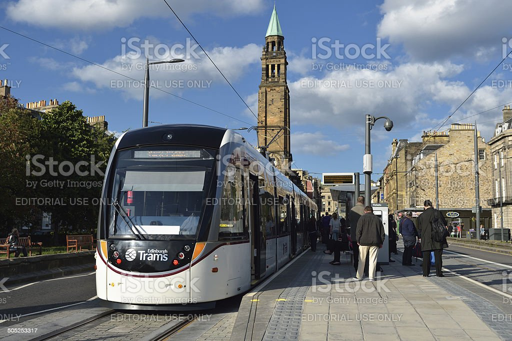 Passengers and an Edinburgh tram at one of the stops stock photo