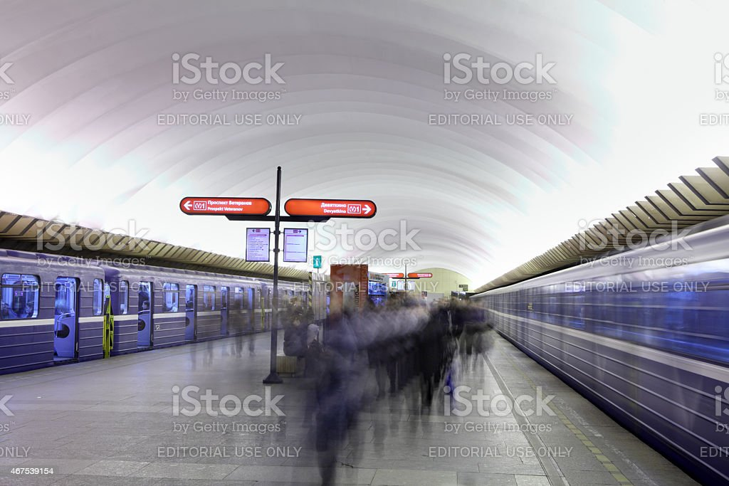 Passengers are on platform at  underground station in  Russian subway stock photo