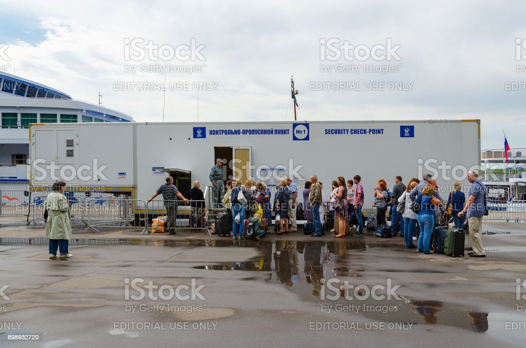 Passengers are on security checkpoint of Northern River Station awaiting landing on cruise ships, Moscow, Russia stock photo