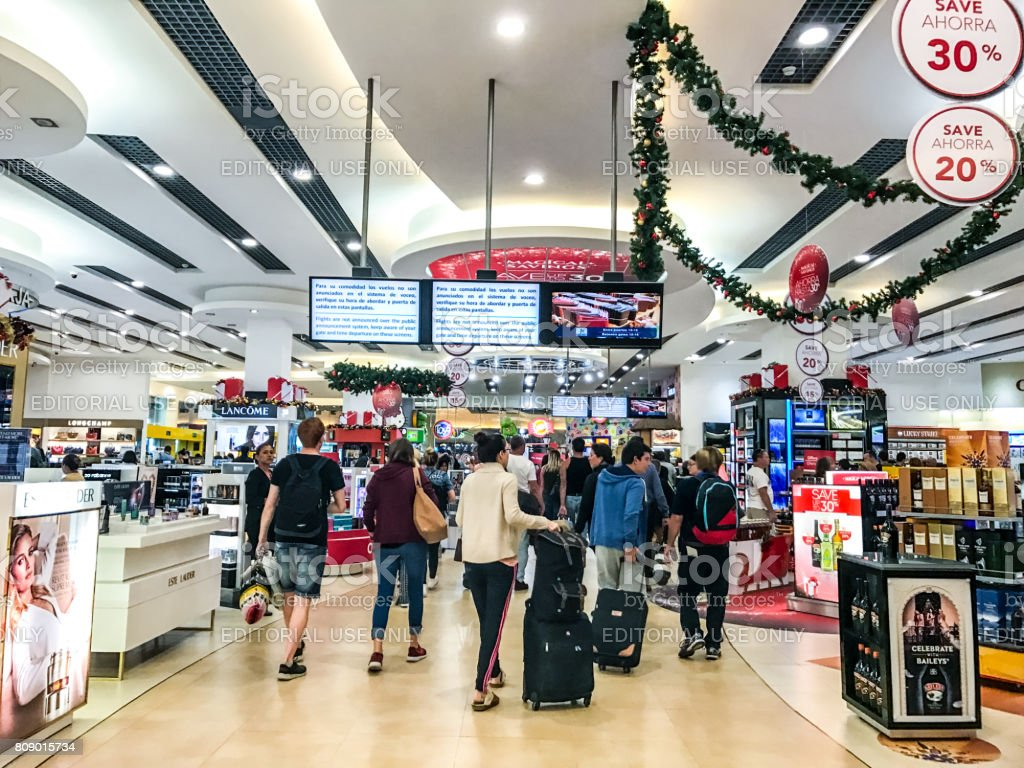 Passengers are shopping in Duty Free shops in Cancun International airport, Mexico stock photo