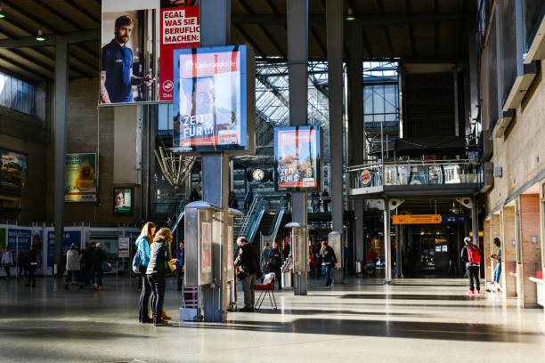 Passengers are walking to the platform and waiting for their transport at the railway station Munchen Hauptbahnhof stock photo