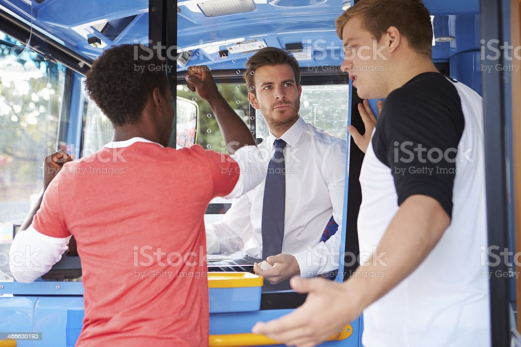 Passengers Arguing With Bus Driver stock photo