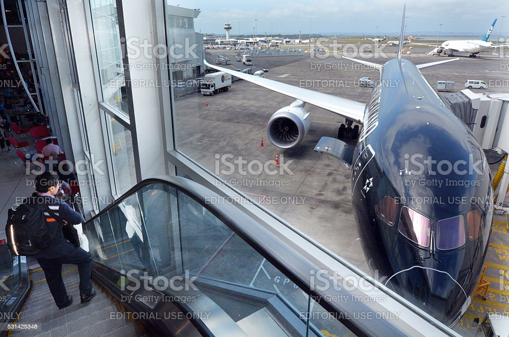 Passengers at Auckland International Airport stock photo