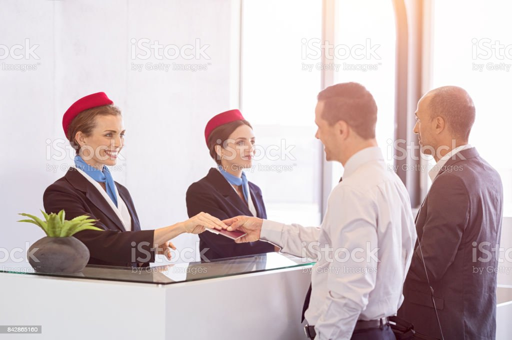 Passengers at check in counter stock photo