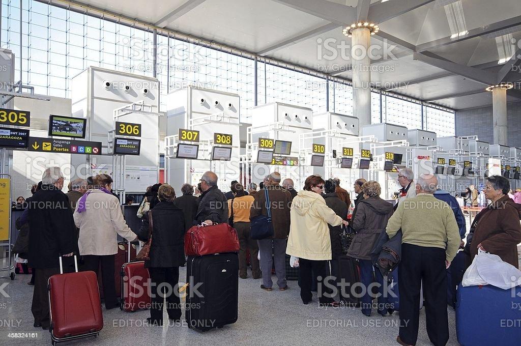 Passengers at check in desks, Malaga airport, Spain. royalty-free stock photo