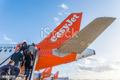 London Gatwick, UK - Nov 23rd, 2017: Passengers board an Easyjet airplane at London's Gatwick airport