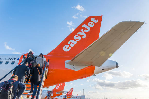 Passengers board an Easyjet airplane at London's Gatwick airport stock photo