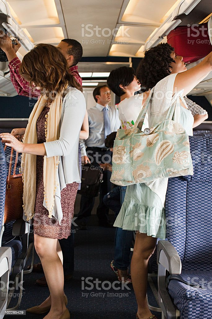 Passengers boarding a plane stock photo