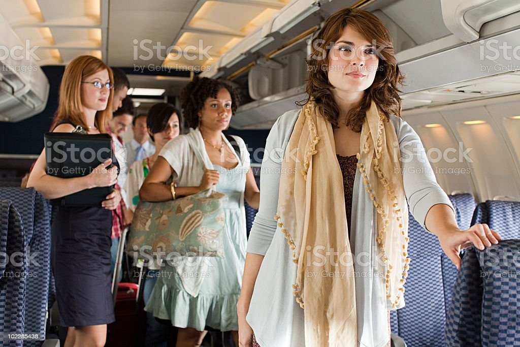 Passengers boarding a plane stock photo