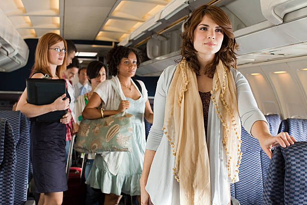 passengers boarding a plane - getting on stock photos and pictures
