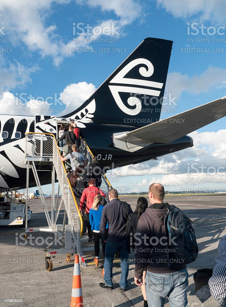 Passengers boarding Air New Zealand flight stock photo
