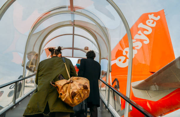Passengers boarding an Airbus A320 easyJet airplane at London Gatwick's North Terminal stock photo