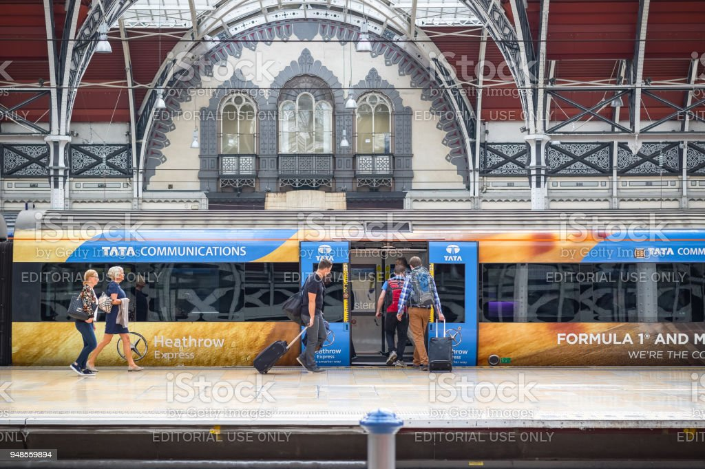 Passengers boarding Heathrow Express at London Paddington station stock photo