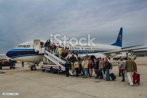 istock Passengers boarding plane 675396236