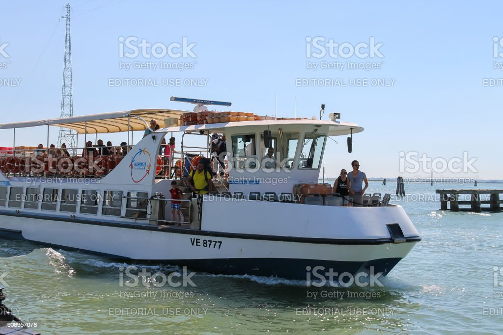 Passengers boat with tourists in the Adriatic Sea near Venice, Italy stock photo
