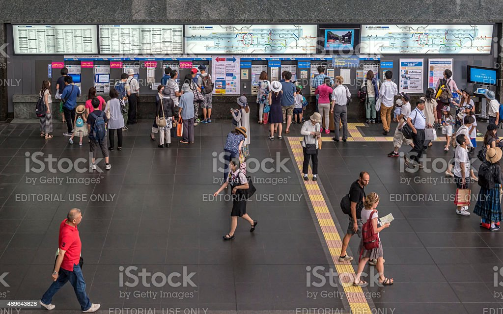 Passengers buy tickets from self service machines stock photo