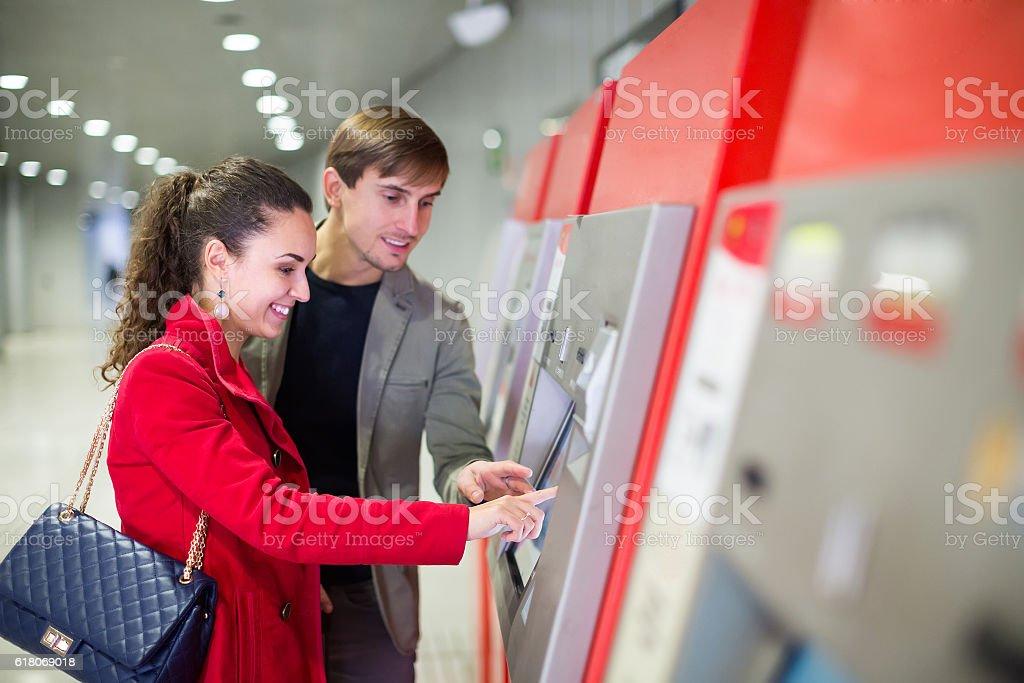 Passengers buying subway ticket stock photo
