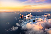istock Passengers commercial airplane flying above clouds 955952680