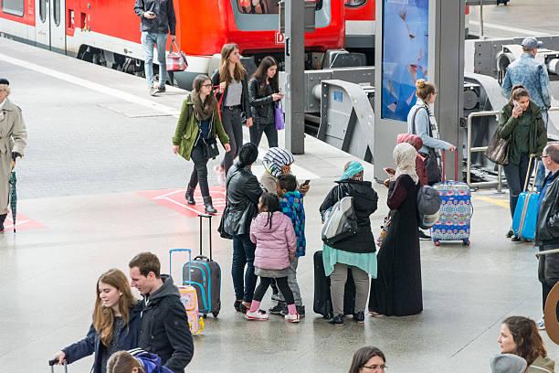 passengers crowded on the platform of hauptbahnhof - munich train station bildbanksfoton och bilder