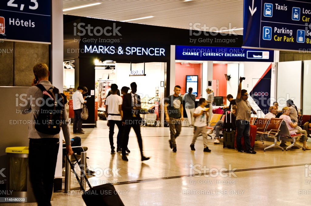 Passengers Customers Patronising A Marks Spencer Shop And A Bureau De Change Kiosk In Paris Charles De Gaulle Airport France Aka Roissy Airport Stock Photo Download Image Now Istock