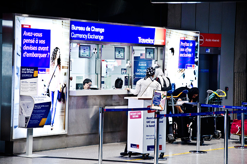 Passengers Customers Patronising A Travelex Bureau De Change Kiosk In At Paris Charles De Gaulle Airport France Aka Roissy Airport Stock Photo Download Image Now Istock