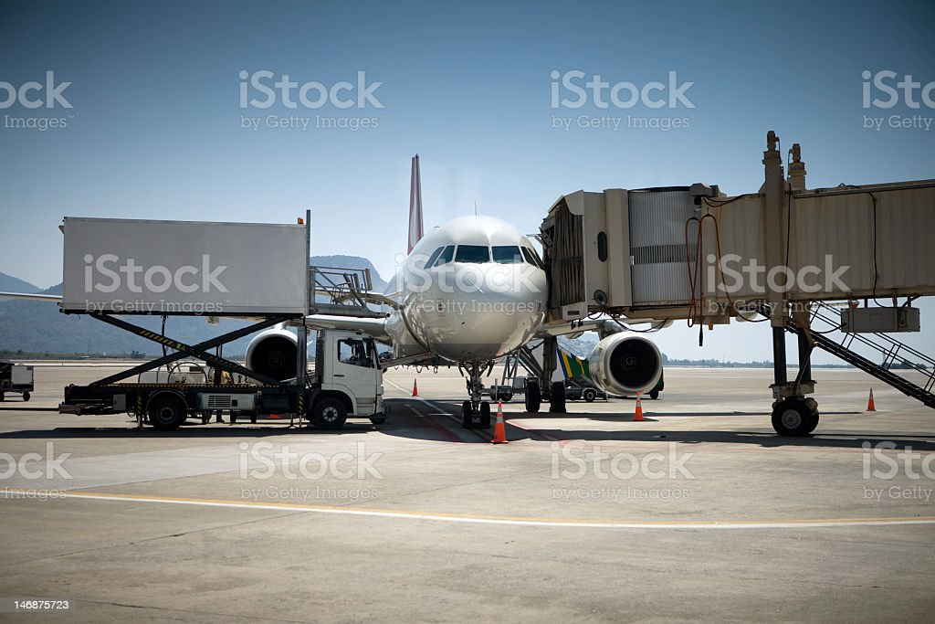 Passengers de-boarding after flight stock photo