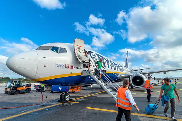 Passengers deplane ryanair airplane after landing in pisa airport picture id535429763?b=1&k=6&m=535429763&s=612x612&w=0&h=dqbj4fmjfv3aewgto319rfiwigipaxnl4tdb8shmlug=