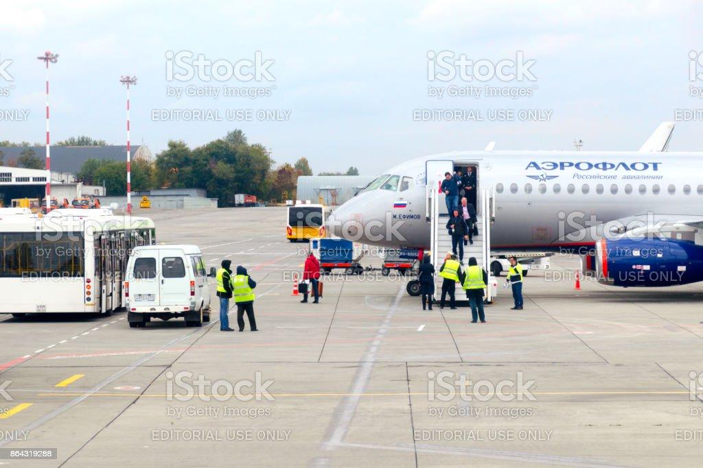 Passengers descend a ladder the plane of the Aeroflot Company. stock photo