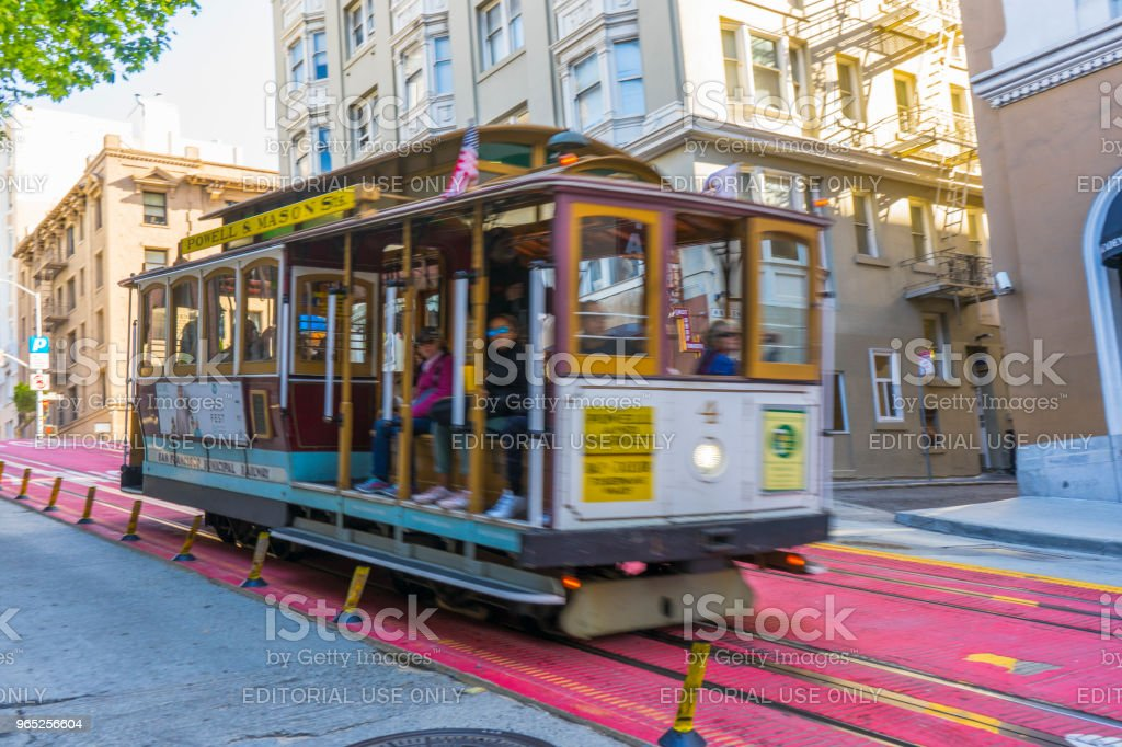 Passengers enjoy a ride on a cable car in San Francisco,California. royalty-free stock photo