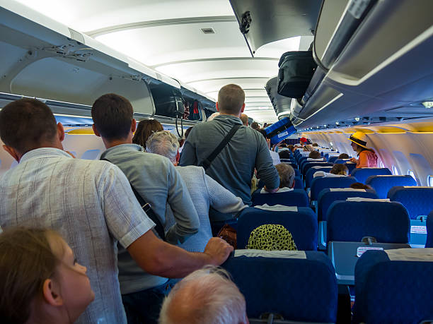 Passengers expect exit the aircraft after landing Flight Simferopol-Moscow stock photo