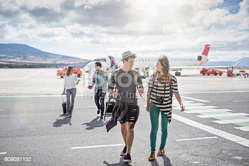 istock Passengers getting out of the airplane on a sunny day 609081132
