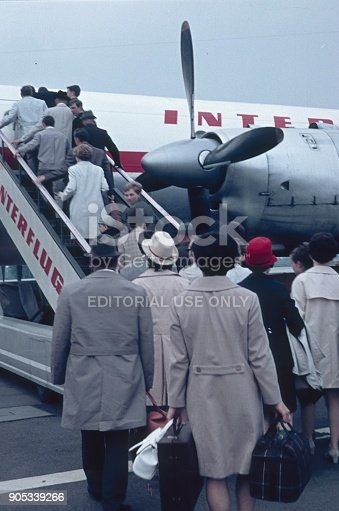 Schönefeld, Berlin, Germany, 1965. Passengers board a passenger aircraft of the former Interflug Airline (East Berlin) via a gangway.