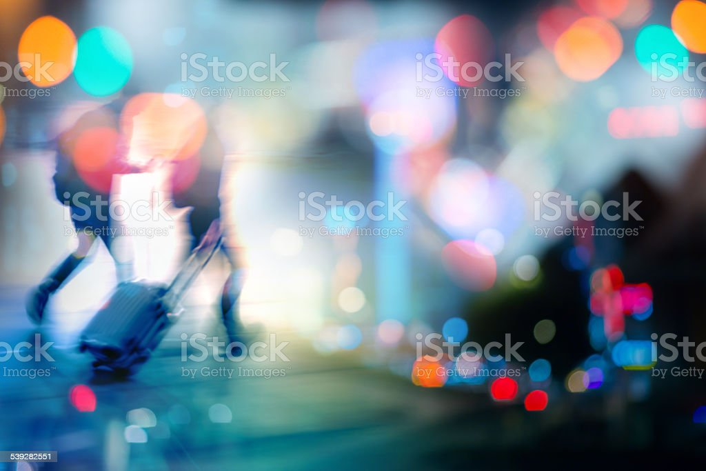 passengers in city background at night stock photo