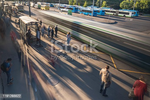 1060957508 istock photo passengers in the queue for boarding the bus on a busy street at the end of the day 1191265522