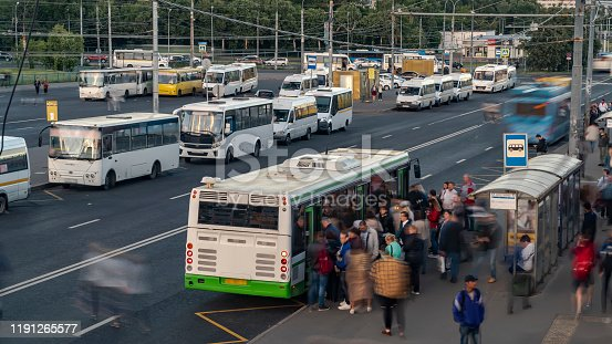 1060957508 istock photo passengers in the queue for boarding the bus on a busy street at the end of the day 1191265577